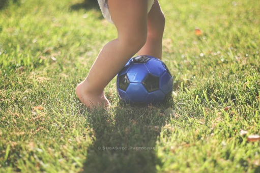 NEW picture of toddler kicking the ball