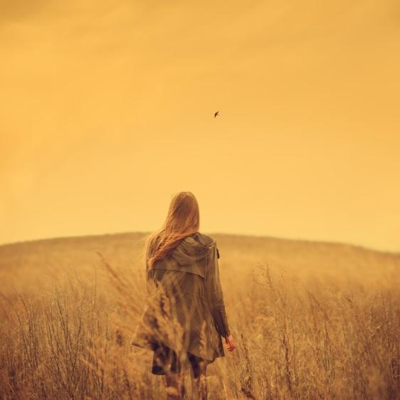 woman walking through the field